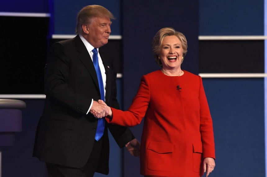 Democratic nominee Hillary Clinton wore a bright red pantsuit and Republican nominee Donald Trump wore a conflower blue tie with his suit to the debate.