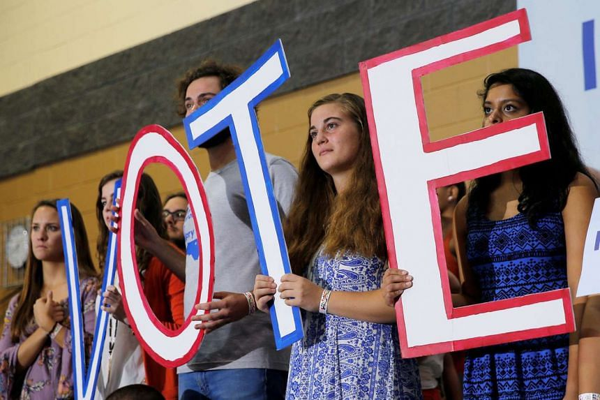 Members of the audience during a campaign rally with Mrs Clinton in Raleigh, North Carolina, on Tuesday. The recent bombings in New York and New Jersey, as well as police shootings of unarmed African-Americans, had spurred demonstrations in the swing stat