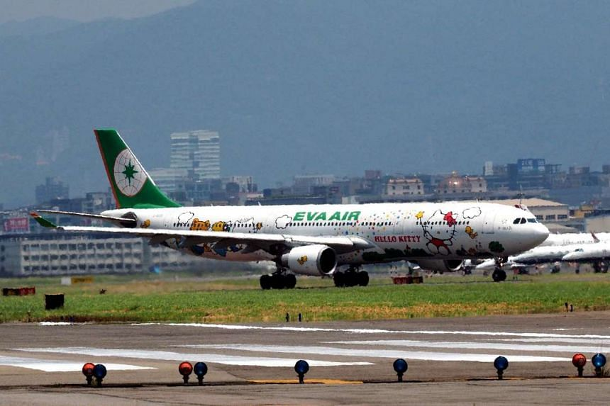 A Taiwanese EVA AIR passenger jet parked at the Taipei Songshan Airport on July 28, 2016.