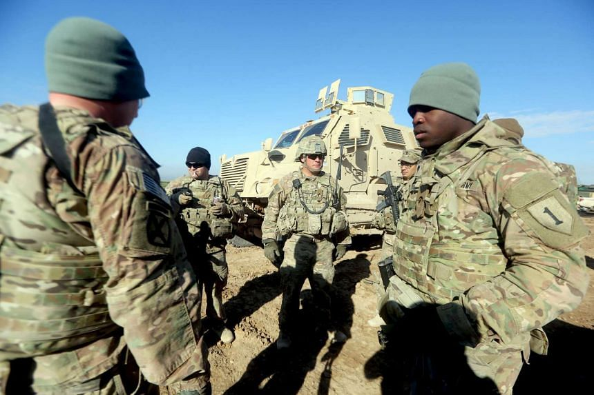 US soldiers train Iraqi counterparts in Basmaya base, south-east of the Iraqi capital, Baghdad, on Jan 26, 2016..