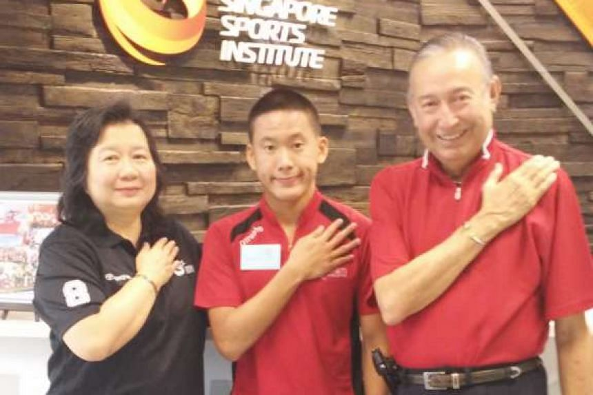 Singapore para-swimmer Benson Tan (centre) with Colin and May Schooling, parents of Olympic gold medallist Joseph Schooling.