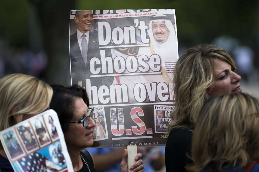 Protesters participate in a rally to protest President Barack Obama's plan to veto the Justice Against Sponsors of Terrorism Act, in front of the White House on Sept 20, 2016.