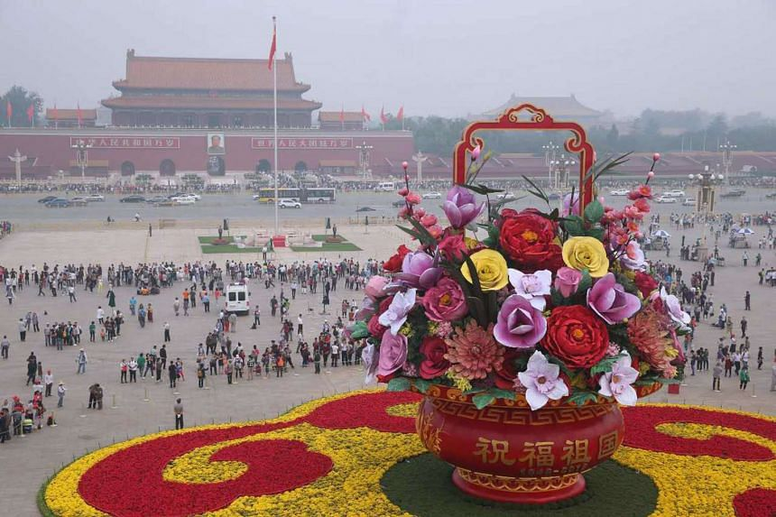 """A huge """"flower basket"""" decoration on Tiananmen Square to mark the upcoming National Day in Beijing."""