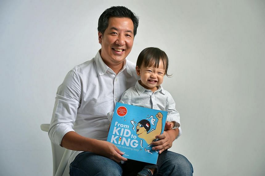 ST News Editor Marc Lim, together with his son, poses with his new illustrated kids' book From Kid to King.