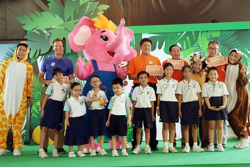 (From left) Community Chest vice-chairman Chew Kwee San, Community Chest chairman Phillip Tan, Minister Ng Chee Meng, and Wildlife Reserves Singapore CEO Mike Barclay pose with children during the Sharity Day celebrations at River Safari.