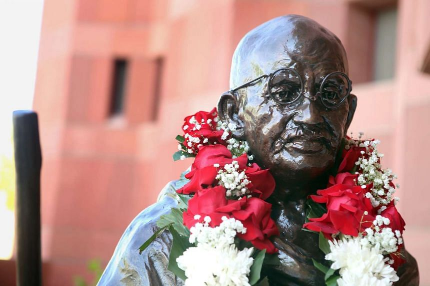 A life-size bronze statue of Indian independence icon Mahatma Gandhi during its unveiling ceremony at the Indian embassy in Kuwait City.