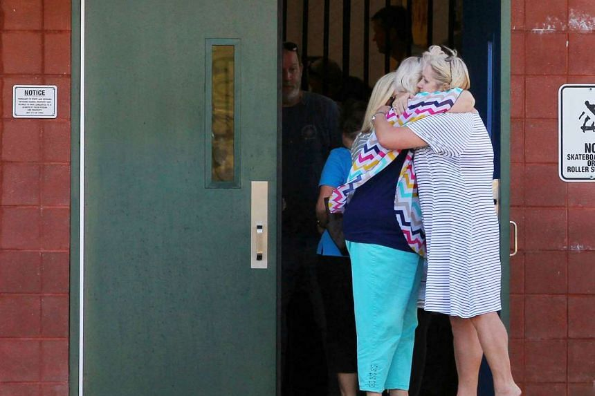 Two teachers hug outside of Townville Elementary School after a shooting at the school on Sept 28, 2016. A first grader who was shot is fighting for his life.