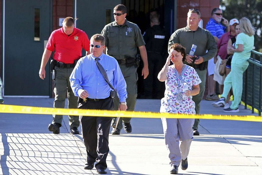 Sheriff's deputies and investigators walk out of Townville Elementary School after the shooting on Sept 28, 2016.