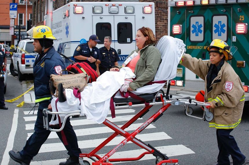 Emergency workers help an injured person.