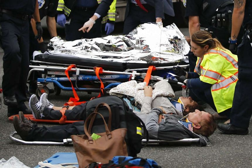 People are treated for their injuries on the street.