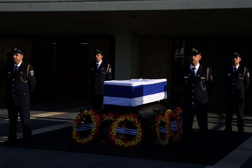 Parliamentary guards stand next to the coffin of former Israeli president Shimon Peres at a plaza outside the Knesset, Israel's Parliament, on Sept 29 in Jerusalem.