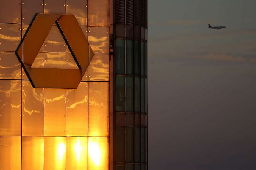 The logo of Germany's Commerzbank is seen in the late evening at its headquarters in Frankfurt. The bank plans to cut 9,600 jobs, nearly a fifth of its workforce, by 2020.
