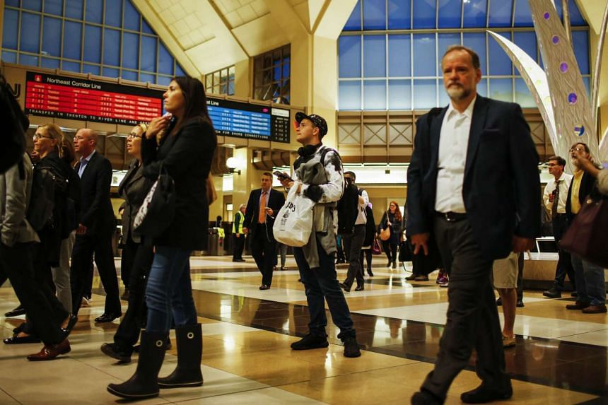 People make their commute from New York to Hoboken through the Secaucus Junction Station after a NJ Transit train crashed in to the platform at Hoboken Terminal on Sept 29, 2016.