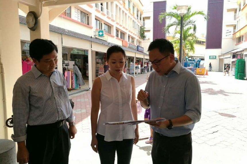 MP Cheng Li Hui receives a brief on the checks from HDB officers on Sept 30, 2016.
