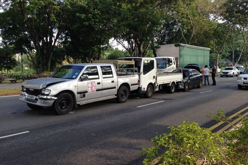 Two lorries and a car were involved in a vehicle pile-up at Bishan Road.