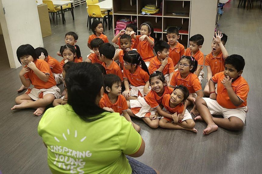 Children in a K2 class participating in Children's Day celebrations at My First Skool in Chin Swee Road yesterday. NTUC First Campus said there are now 12 programmes - from three in 2008 - to meet the social needs of its pre-schoolers, such as improv