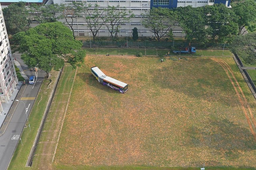 An SMRT bendy bus was stuck on a field behind Block 195, Kim Keat Avenue, for about 10 hours before it was finally towed away yesterday morning. The bus driver was returning the off-service vehicle to the depot in the early hours of the morning when