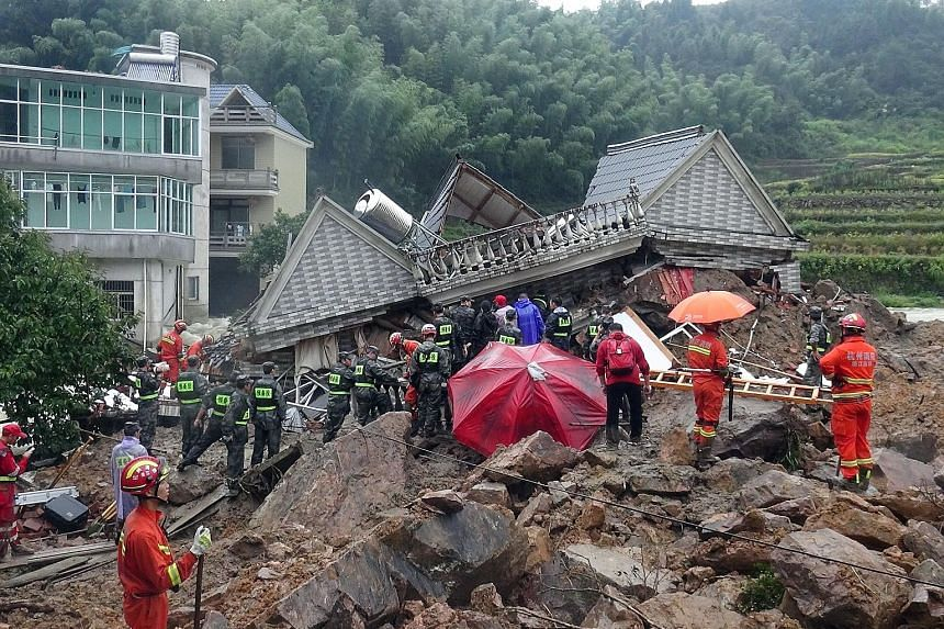 Rescuers search for survivors among the rubble in Sucun village in Zhejiang province yesterday.