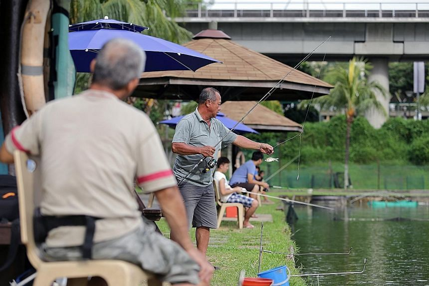 Anglers on a small boat in the open waters around the Southern Islands. Because of its deep waters, Bedok Jetty is a favourite spot with anglers hoping to reel in the big one. Mr Johnny Ng, 56, at Fishing Paradise at Orto.
