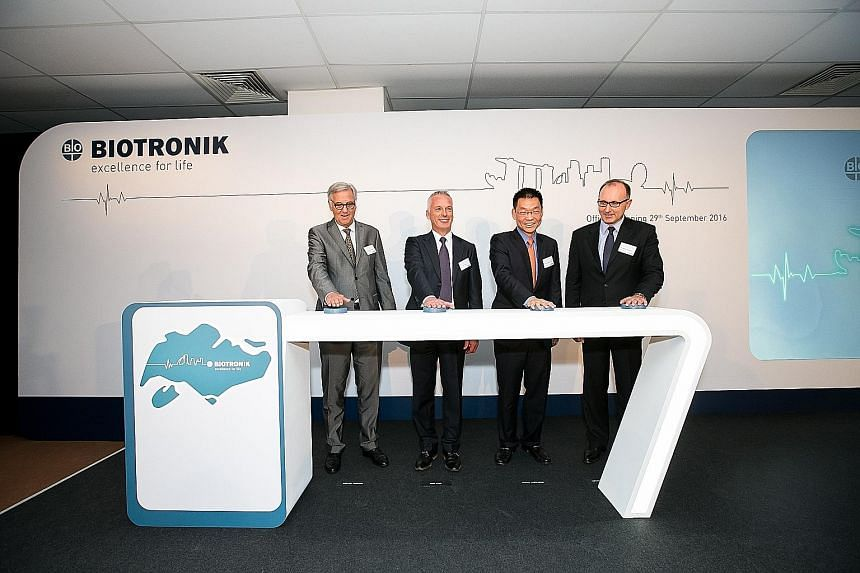 Biotronik, a leader in cardio- and endovascular medical technology, makes equipment like pacemakers (above). Its new Singapore facility (below) will be manufacturing components for its latest products. From left: Dr Michael Witter, Ambassador of the