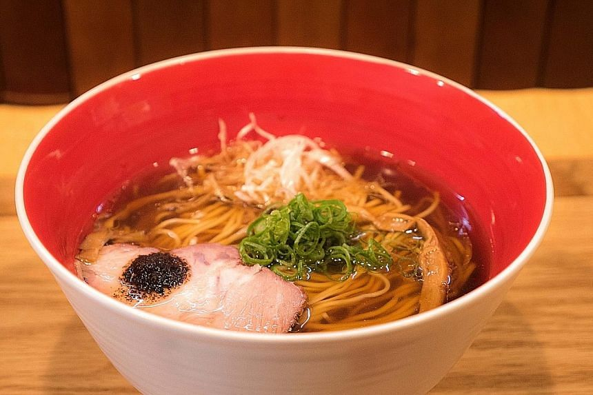 Tsuta's Singapore menu will feature its signature shoyu (above) and shio ramen. Tsuta chef- owner Yuki Onishi created his ramen with a modern spin by adding Western ingredients.