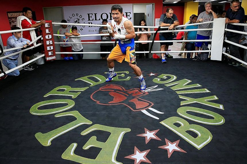 "Senator and boxing champion Manny ""Pacman"" Pacquiao training in the Elorde gym in metro Manila on Wednesday, in preparation for his bout with Jessie Vargas on Nov 5 in Las Vegas. Mr Pacquiao says his friendship with President Duterte dates back at le"