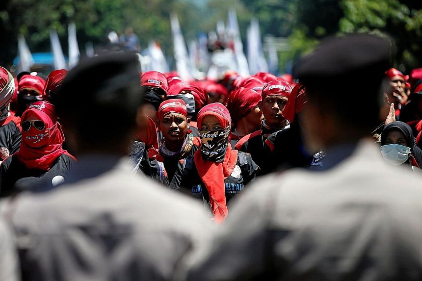 The protest march near the presidential palace in Jakarta yesterday.