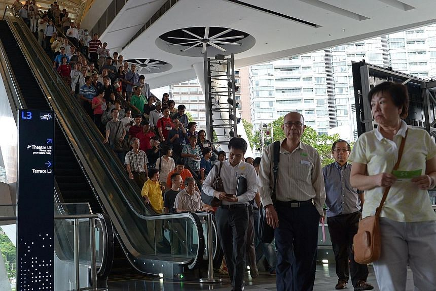 Shareholders leaving the SMRT meeting at Star Vista mall yesterday. The meeting went on for so long - almost four hours in total - that some bento boxes meant for investors had to be thrown out as they passed their use-by time. A glitch in electronic