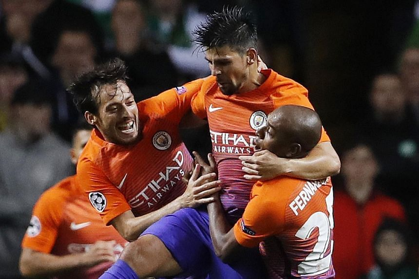 Manchester City's Nolito (centre) celebrates scoring their third goal with team-mates David Silva (left) and Fernandinho. The Premier League leaders had to equalise thrice to earn the point against Glasgow Celtic.