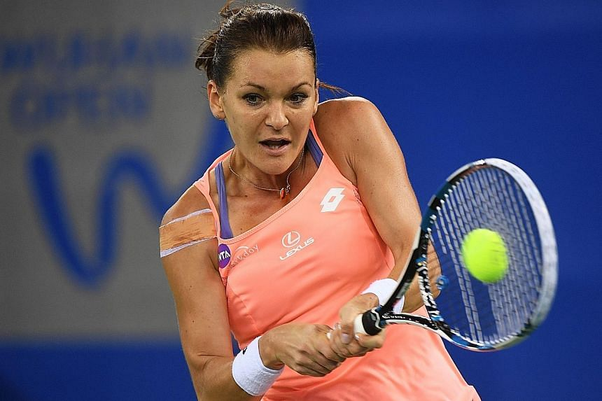 Reigning WTA Finals champion Agnieszka Radwanska hitting a backhand during her Wuhan Open quarter-final loss to Svetlana Kuznetsova yesterday. The Pole is fourth in the Road to Singapore standings.