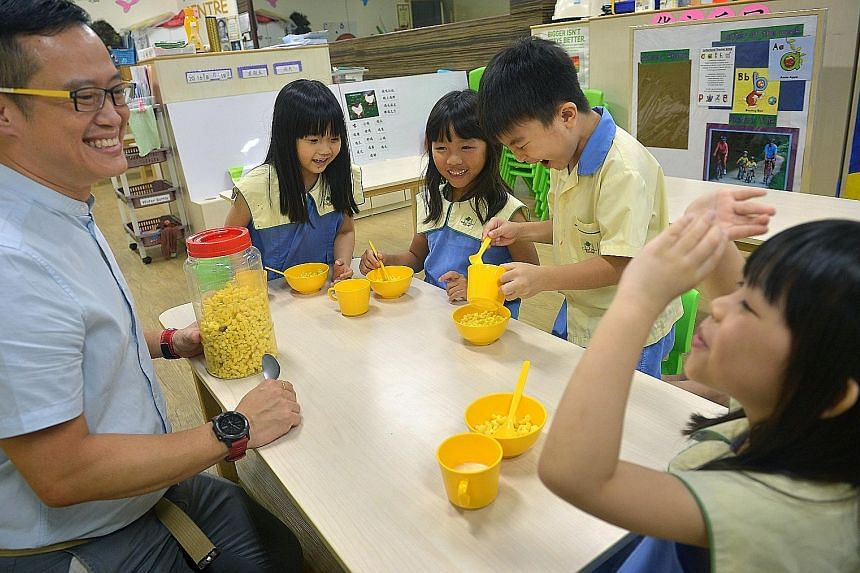 A research project on diabetics will focus on the lifestyle of pre-schoolers such as Carpe Diem @ ITE K2 pupils (from left) Low Yen Qi, Joyce Pek, Ng Guan Zhi and Kang Jia En, all six. With them is Mr Lorbert Tay, 42, the centre manager.
