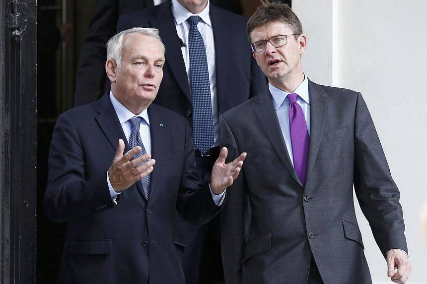 France's Foreign Minister Jean-Marc Ayrault (left) and Greg Clark Britain's Secretary of State for Business leave 10 Carlton House Terrace in central London on Sept 29, 2016.