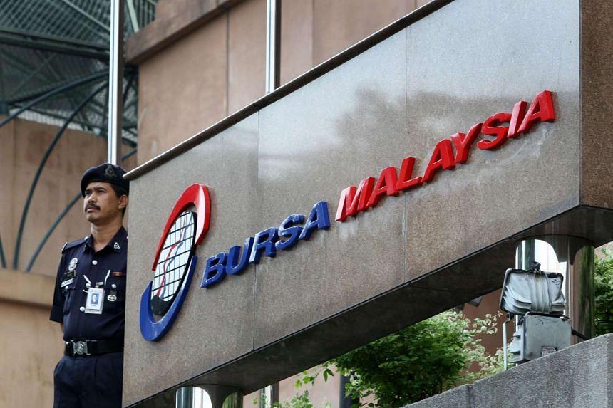 A security guard on patrol at the Bursa Malaysia Bhd. headquarters in Kuala Lumpur.