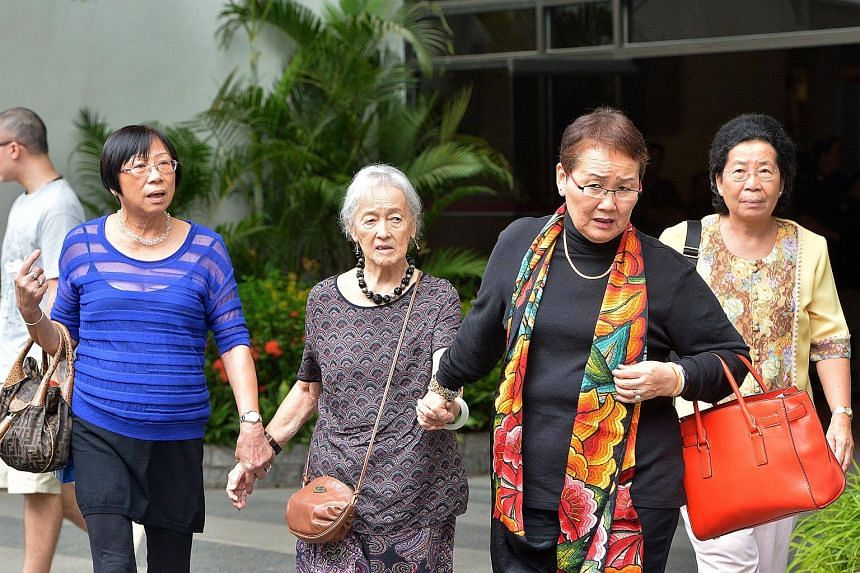 Madam Chung Khin Chun and Madam Hedy Mok walk out of court with their friends and supporters.