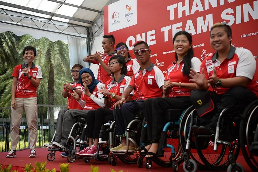 Minister for Culture, Community and Youth Grace Fu (left) with Singapore's paralympians during the One Team Singapore Celebratory Parade at Vivocity on Sept 24, 2016.