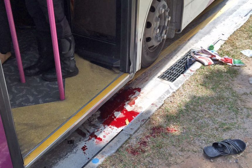 Blood stains under the bus which knocked down a man at Hougang Avenue 9 on Sept 30, 2016.