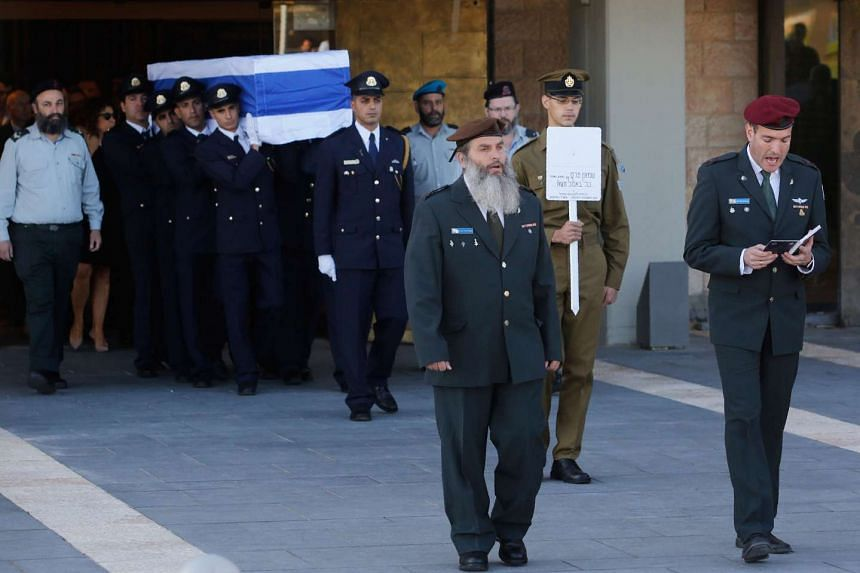 Members of the parliamentary guards carry the coffin of former Israeli premier Shimon Peres at the Knesset, Israel's Parliament, at the start of his funeral in Jerusalem on Sept 30, 2016.