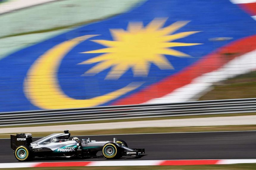Lewis Hamilton drives his car during the first free practice session of the Formula One Malaysia Grand Prix in Sepang on Sept 30, 2016.