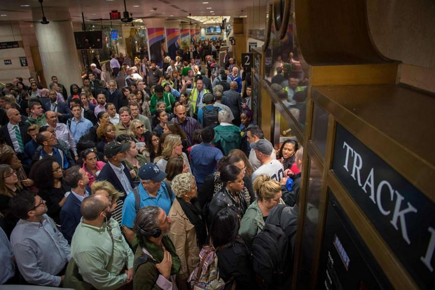 Commuters are seen at the New Jersey Transit platform after a train accident at the Hoboken Train Terminal.