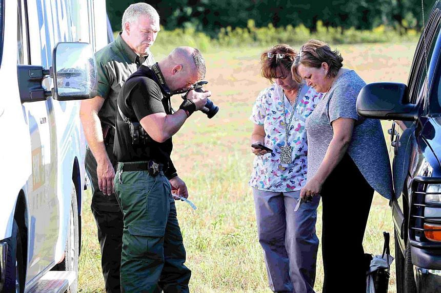 Anderson County sheriff's deputies gathering evidence outside of Townville Elementary School in Townville, South Carolina, US, on Sept 28, 2016.