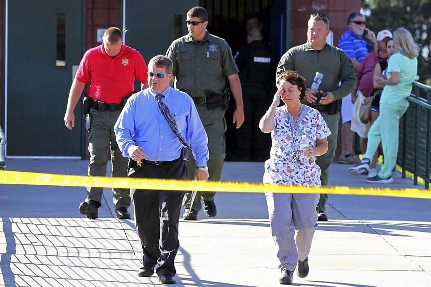 Anderson County sheriff's deputies and investigators walking out of Townville Elementary School after a shooting in Townville, South Carolina, US, on Sept 28, 2016.