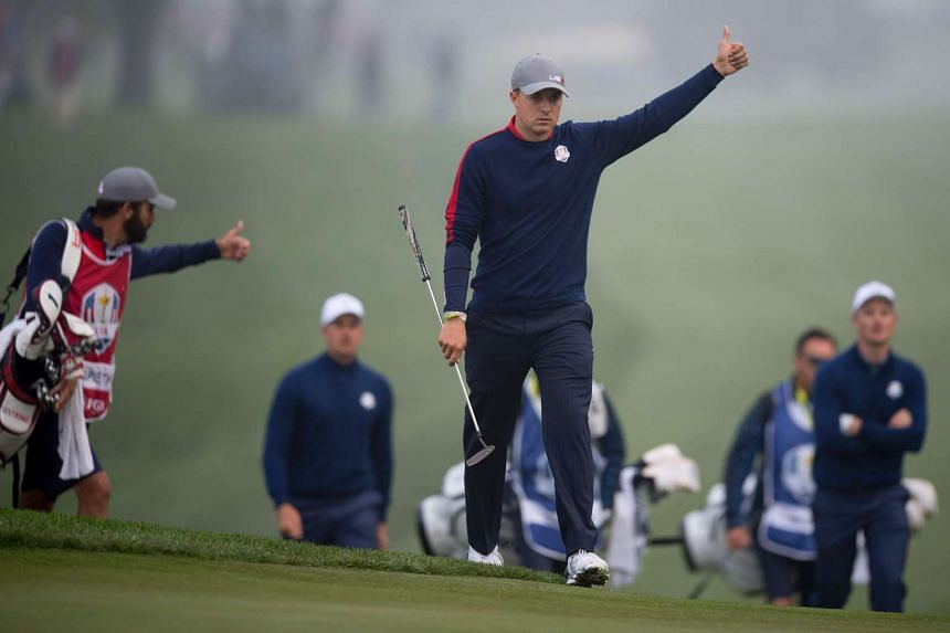 Jordan Spieth gives a thumbs up to his partner while playing the Morning Foursome matches at the 41st Ryder Cup.