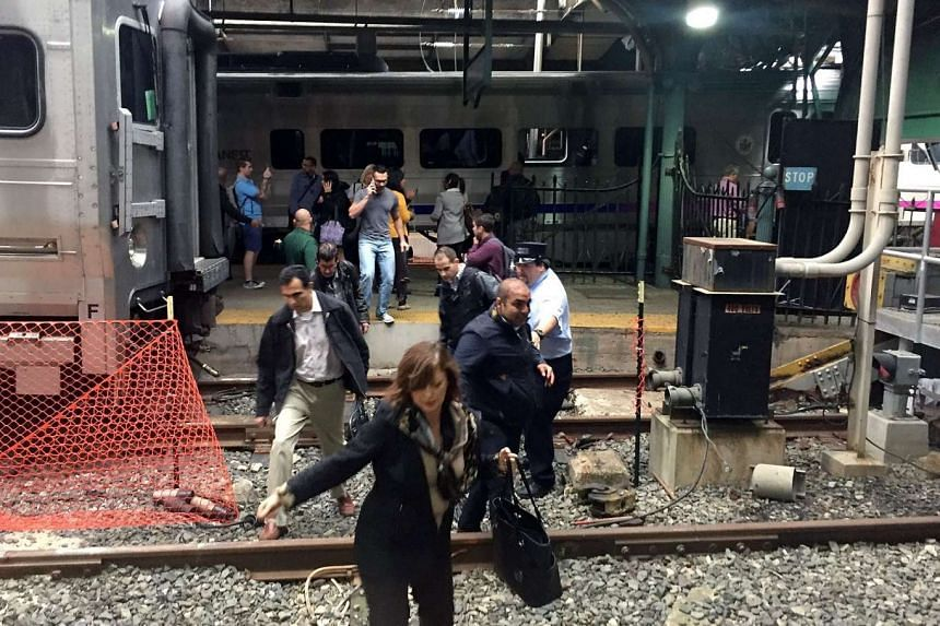 Passengers rush to safety after a train crashed into the platform at the Hoboken Terminal in New Jersey on Sept 29, 2016.