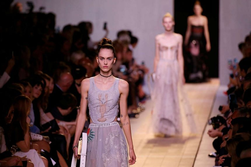 Models present creations by Italian designer Maria Grazia Chiuri as part of her fashion collection for Dior.