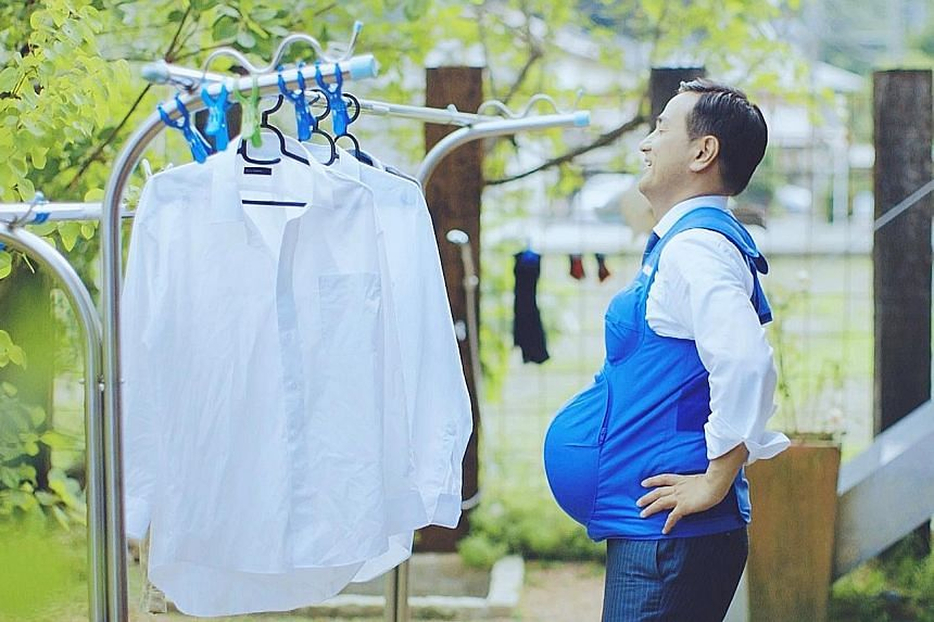 Mr Tsugumasa Muraoka, governor of Yamaguchi prefecture, wearing a vest that recreates the breasts and belly of a woman who is seven months' pregnant, in a video called The Governor Is A Pregnant Woman. In Japan, where women do five times as much hous