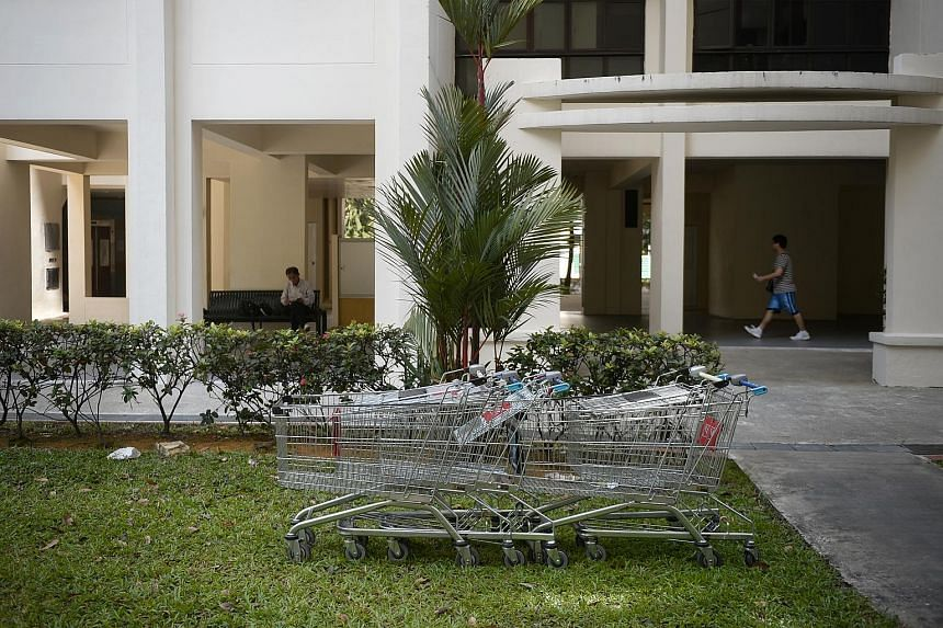 "Trolleys found abandoned near a block in Jurong West. Last month, ""trolley enforcement officers"" were introduced by FairPrice at Jurong Point."