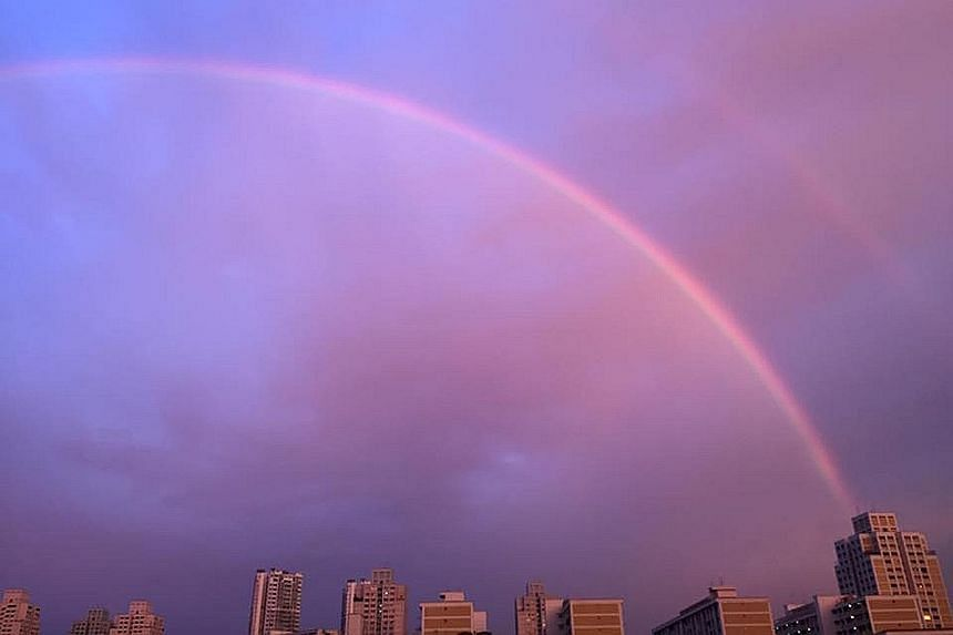 The double rainbow seen from Bishan (left) and the Singapore Swimming Club (above). Yesterday evening's phenomenon was widely shared on social media, accompanied by cheerful captions and emojis.