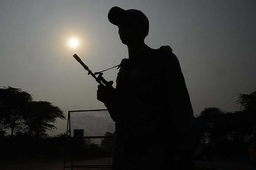 A soldier from the Indian Border Security Force standing guard at the India-Pakistan border crossing in Wagah on Thursday. India yesterday evacuated thousands of people near the border in northern Punjab while villagers in parts of Kashmir were also