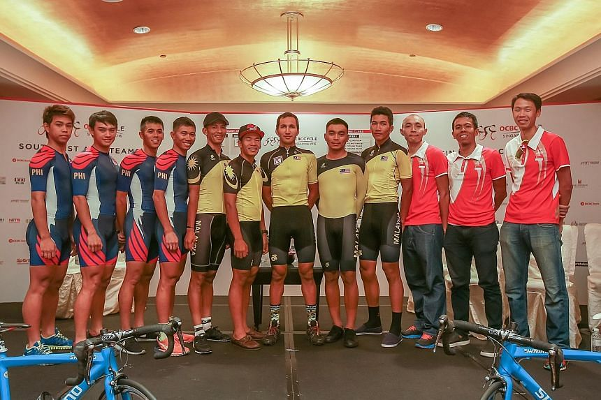 From left: The Philippines, Malaysia and Singapore teams line up for a photo call at Grand Copthorne Waterfront Hotel, ahead of this year's OCBC Cycle South-east Asia Speedway Championship.