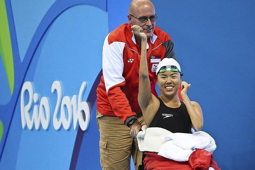 Sport Singapore chief Lim Teck Yin (left) and Minister for Culture, Community and Youth Grace Fu addressing the media yesterday. Para-swimmer Yip Pin Xiu celebrates winning gold in the women's 50m backstroke S2 race. She won two golds in Rio de Janie